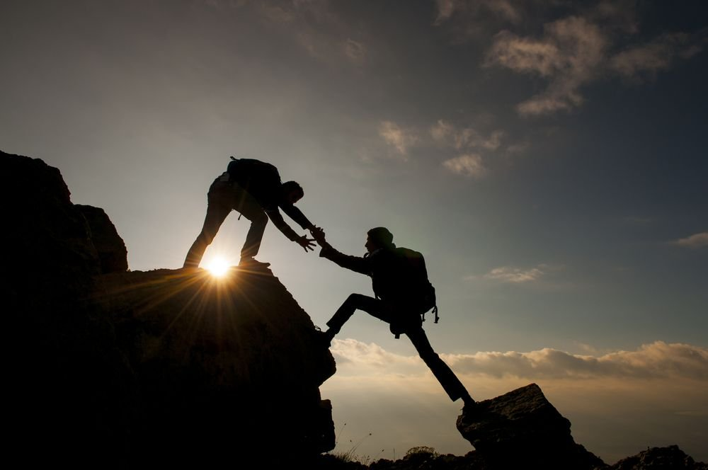 person-helping-climb_1024x1024